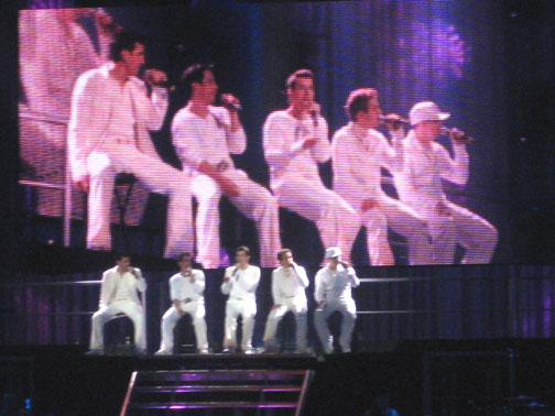 Matching white outfits in classic boy-band style